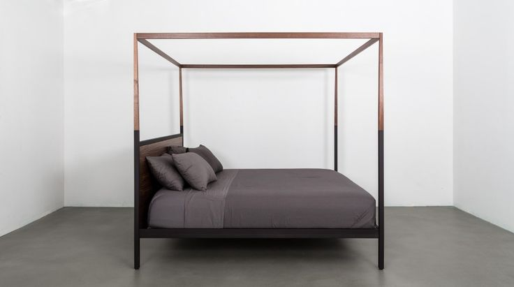 Uhuru Design's contemporary update to a Victorian canopy bed, combining steel & wood in a handmade reinterpretation of the classic.
