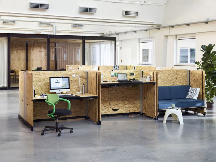Hack by Konstantin Grcic for Vitra - It is made from rectangular oriented strand board (OSB) panels that slot into metal brackets, allowing the desk surface to be raised or  lowered to allow users to work sitting or standing.