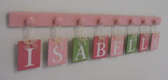 Baby Girl Nursery Decor Name Wall Hanging Letters Custom for ISABELLA - 8 Wood Hooks Pink and Green Nursery via Etsy