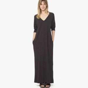 This Raglan Dolman Dress has a single folded V neck binding. Dolman sleeves that hit above the wrist. On seam side pockets with a clean finished hem and sleeves. Dress provides stretch and slight mélange jersey texture and an ultra soft hand feel. Additional Information: