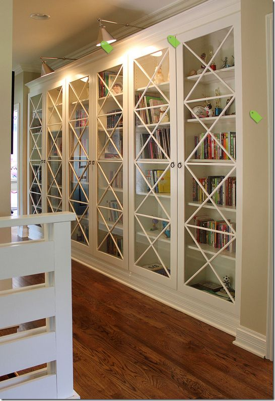closet decor ideas in family room design ideas with fair accent lighting baseboard beige walls book shelves crown molding glass front doors