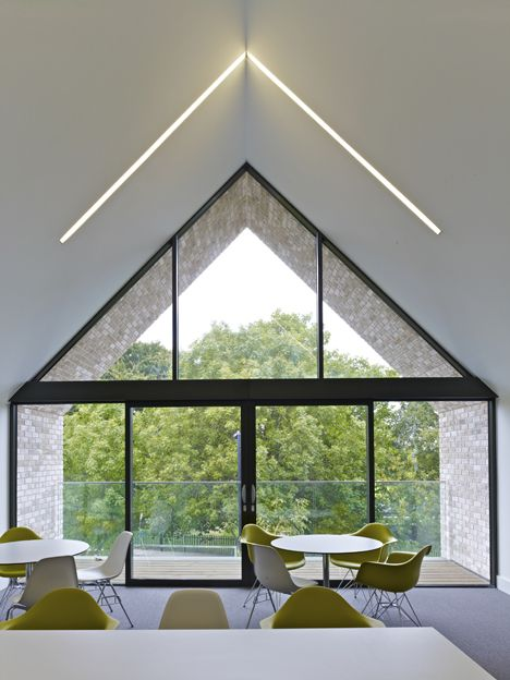 North London Hospice by Allford Hall Monaghan Morris. I love how the ceiling light mirrors the window and roof shape.