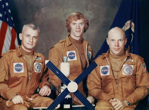 Rusty Schweickart sporting his early-1970s hair commands Skylab 2's backup crew. He is flanked by Bruce McCandless and Story Musgrave.
