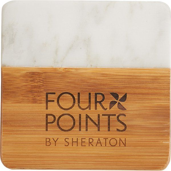 This chic four piece coaster set is crafted from marble and bamboo. The coasters are square with rounded corners. These on trend coasters are perfect for the home or office. Decoration on all four coasters. Packaging: 1-piece black gift box.