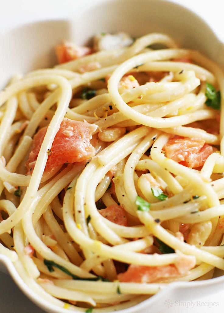Smoked salmon with pasta in a sauce of shallots, garlic, white wine, lemon, and cream, with toasted pine nuts and parsley. EASY! Cooks up in 30 minutes. So creamy, a great way to enjoy smoked salmon. On SimplyRecipes.com