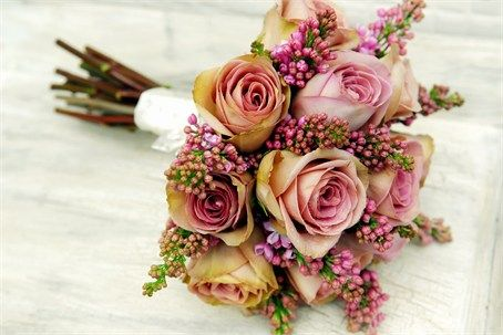 A hand tied bridal bouquet of antique Amnesia Roses and Lilac Lilac