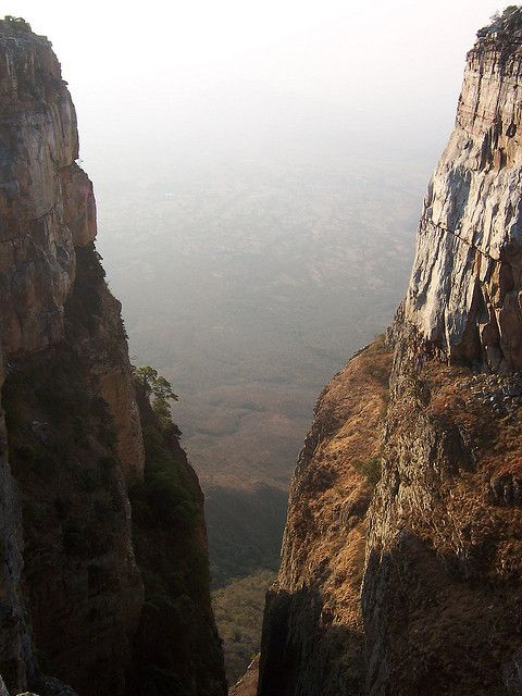 Part 1: 2. This is Tundavala, Angola. It is a viewpoint in the Serra de Leba. The two sides symbolize the two seasons Angola has. The first season is the dry season. It occurs from May to October. The second season is very hot and humid. It is from November to April. During the cold, Angola is usually around 60 degrees F. During summer, Angola is around 70 degrees F. The weather does not make extreme changes.