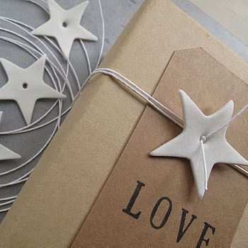 White star gift wrap decoration with white paper string