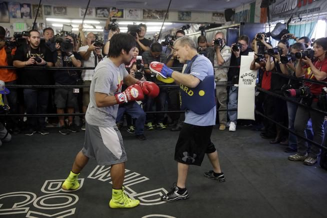 Manny Pacquiao, left, trains with Freddie Roach at Wild Card Boxing Club in Los Angeles. Roach's dream is to concoct a game plan that would allow