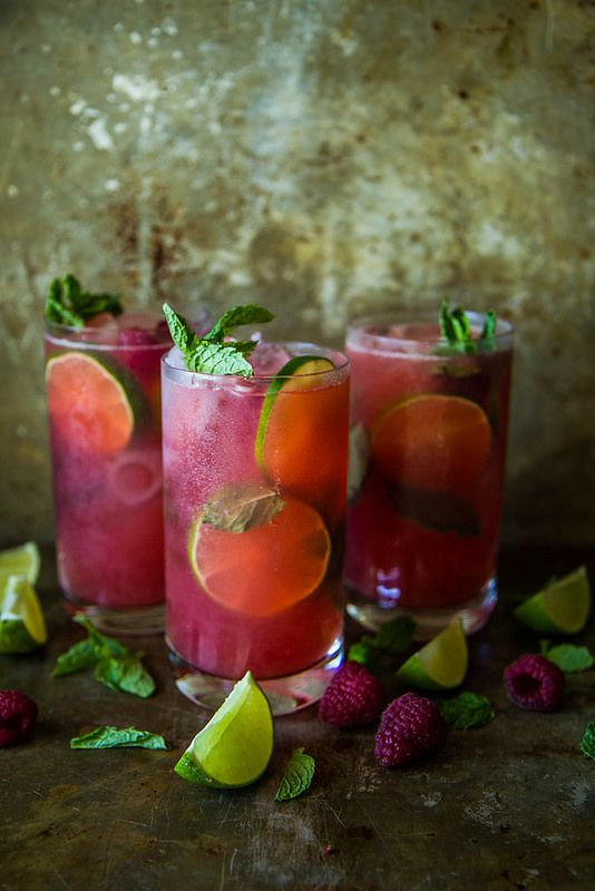 Bright summer wedding cocktail idea - raspberry mojitos {Courtesy of HeatherChristo.com}