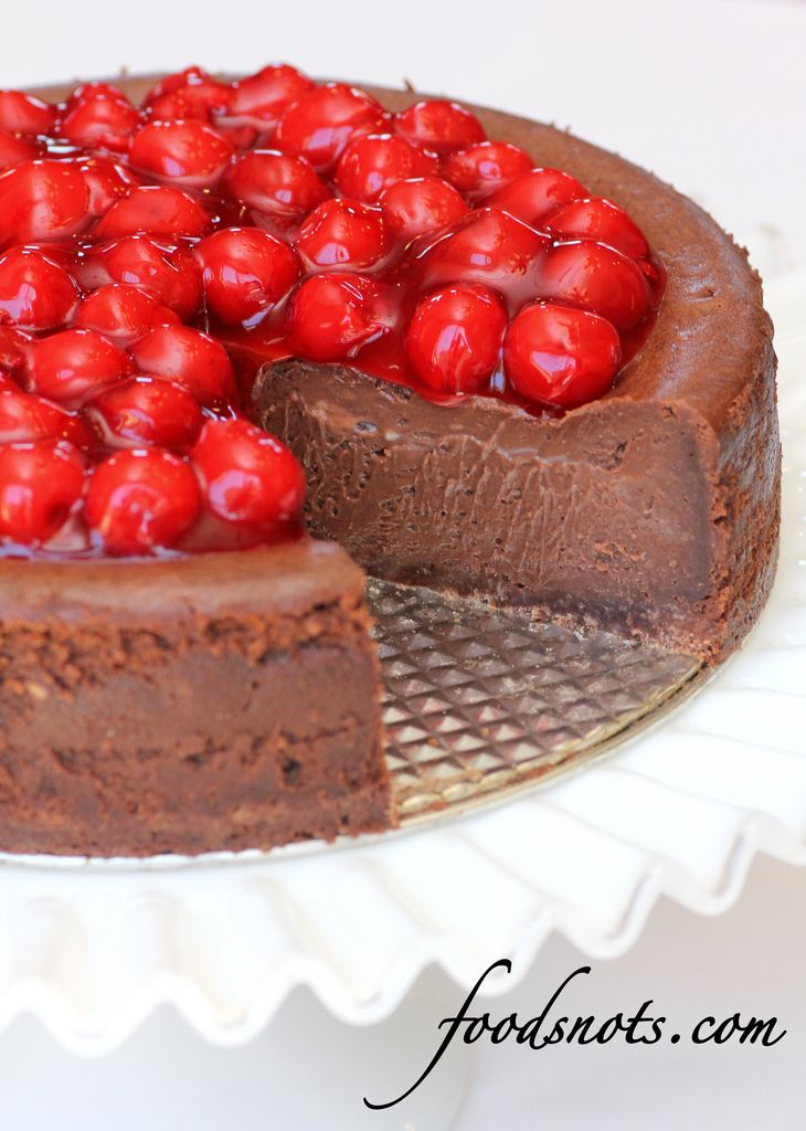 Fudge Brownie Cheesecake... simple and looks delicious. This has cherries on it, yuck. I would do strawberries.