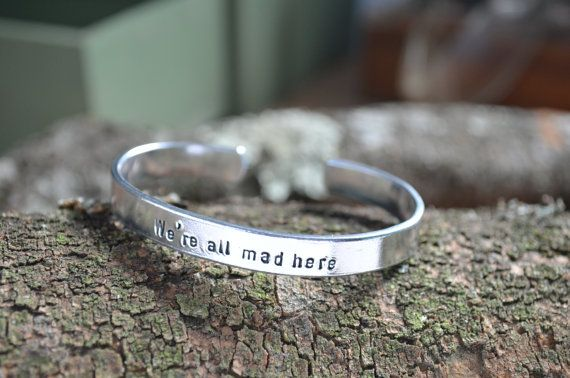 Alice in Wonderland Jewelry, Were All Mad Here, Gifts For Girlfriend, Girlfriend Gift, Alice in Wonderland, Personalized Bracelet   Were all mad here, as said by the Cheshire Cat in Alice in Wonderland. On backside was personalized with Im mad. Youre mad. This make a great giftfor many occasions! Alice in Wonderland party gift, Mad Hatter Tea Party, Birthdays, Christmas....for children, men or women!  Unisex Cuff band bracelet hand stamped and made of Pure Aluminum, copper, brass, or silver…