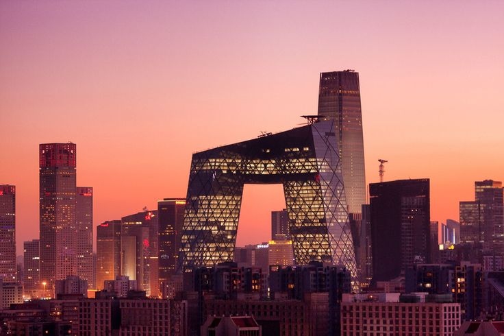 "The CCTV building in Beijing, the headquarters of China Central Television designed by Rem Koolhaas and Ole Scheeren, has a contorted form that frames an enormous void at its center. The Beijing people call it ""the pants"" 裤子"