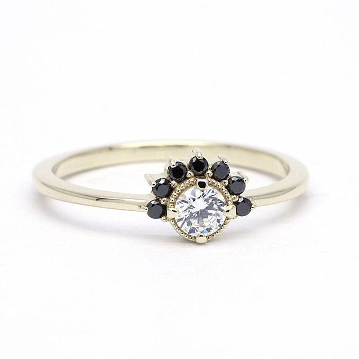 A personal favourite from my Etsy shop https://www.etsy.com/uk/listing/536580354/cluster-engagement-ring-yellow