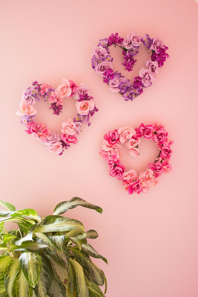 Transform dollar store flowers into these pretty heart wreaths - perfect decor for Valentine's Day or year round! | http://www.designimprovised.com