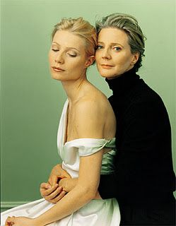 The simple, identical and graceful lines of their posture contrast with their hands: the tight grip of Blythe's hands around her daughter's waist while Gwyneth's hand rests languidly in her lap. The stark difference in clothing: black and white, turtleneck vs. off the shoulder. Direct vs. averted gaze. I love everything about this photograph.