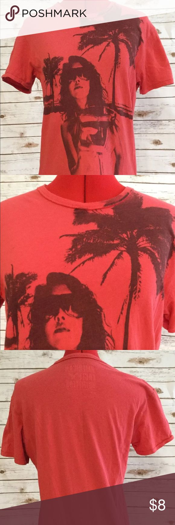 American Eagle Outfitters Graphic T-Shirt This t-shirt is a Live Your Life logo in vintage Iit depicting a beach scene. Very casual. American Eagle Outfitters Tops Tees - Short Sleeve