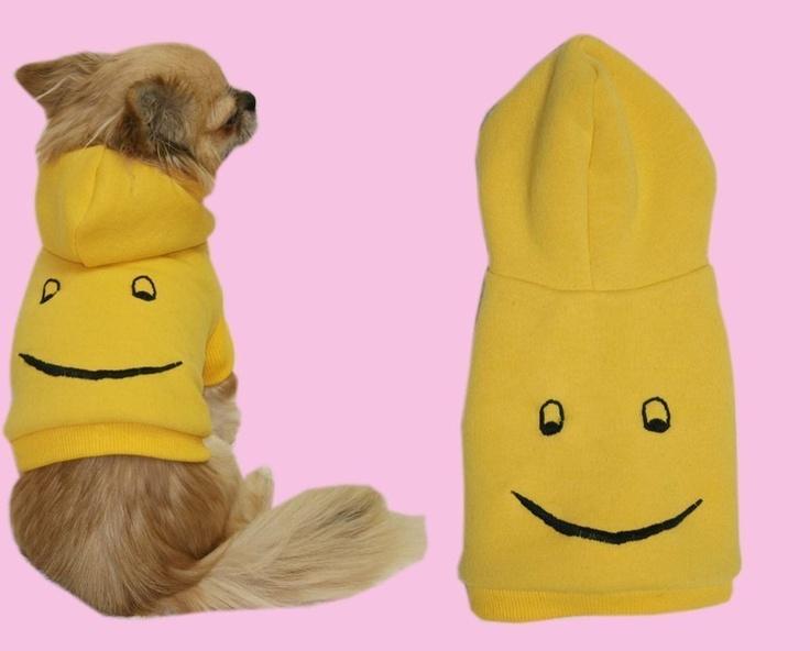 *Keep on smiling!*    Sonniger gelber Hoodie mit aufgesticktem Smiley-Gesicht.  Angenehm flauschige Innenseite mit Kuschel-Effekt.  Gelbes Rippbünd...