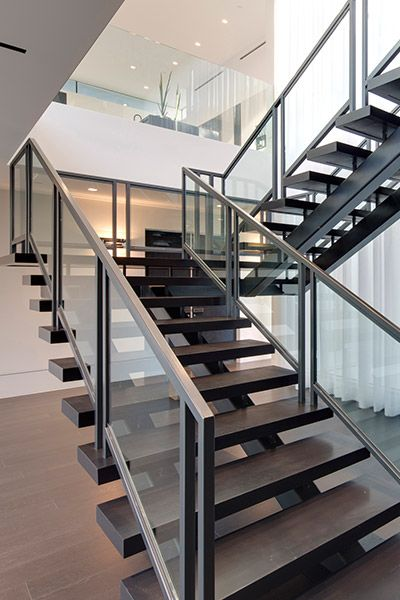 Modern staircase in Beverly Hills mega mansion by McClean Design