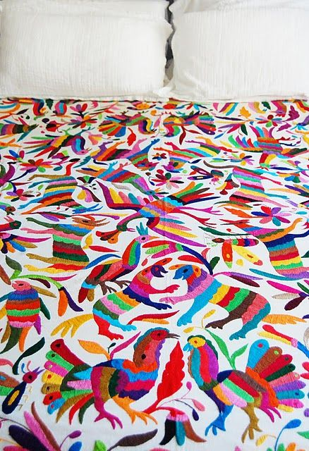 Hand-embroidered coverlets, known as tenangos, are crafted by the Otomi indians from the mountains of the Mexican state of Hidalgo.