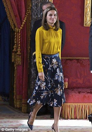 The Spanish Queen looked immaculate in a bold yellow blouse and chic midi skirt as she joi...