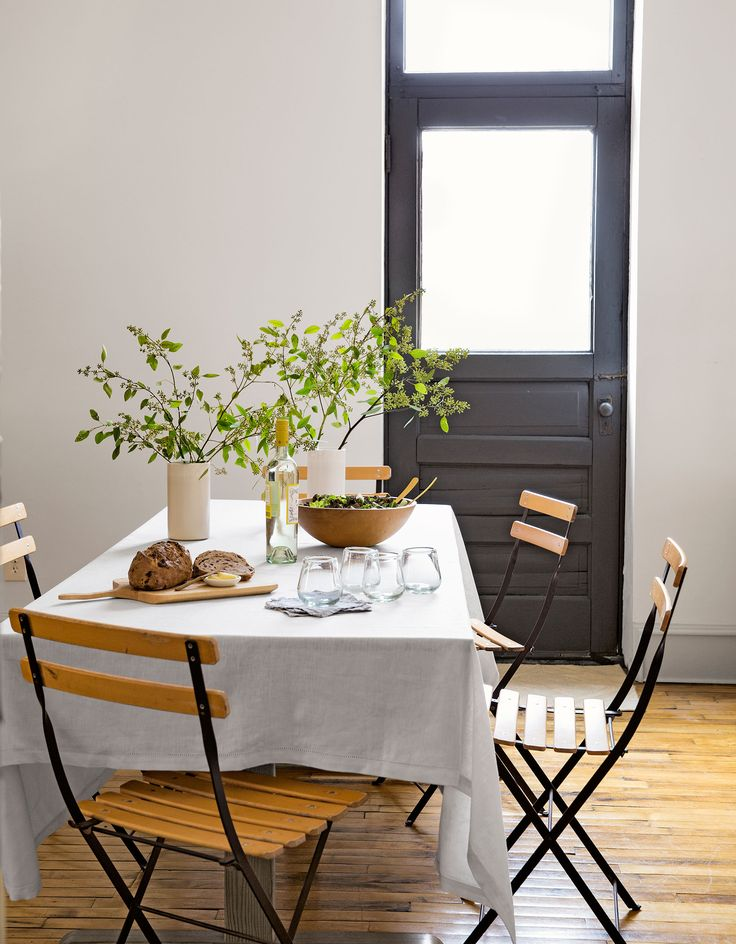 Folding cafe chairs from Smith & Hawken take up little space in the tiny dining area of this Minneapolis loft. The owner spruced it up after being inspired by her family's farmhouse.   - CountryLiving.com