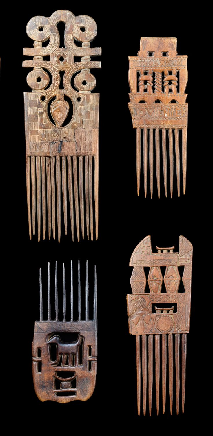 Africa | Four ornamental combs from the Akan people of Ghana | Wood | One comb is dated 1957.
