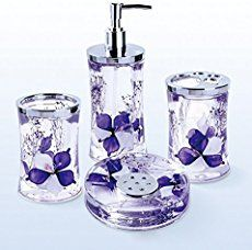 Purple bathroom decor is fun, unique and pretty.  I love all the different ways to add purple to a bathroom.  Some of my favorite purple bathroom decorating ideas include using purple shower curtains, purple soap holders, purple trash cans in combination with purple wall art, purple decorative accents, purple bath mats.  Together with using both light shades of purple such as lavender and lilac you can create a relaxing paradise.