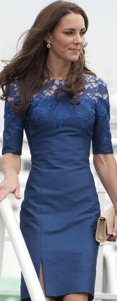 Blue pencil dress with lace applique and a side slit. Love her style.....