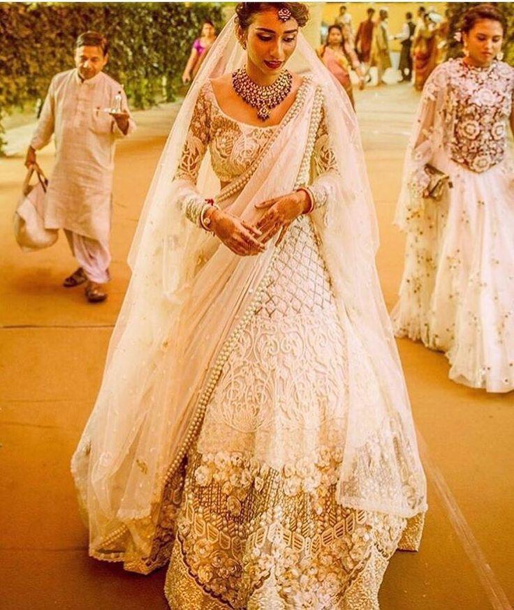 Never seen a lehenga that complements the bride's beauty so well. #bridaloutfit #bridallehenga #whitelehenga #lehengainspiration #indianweddings #shaadisaga