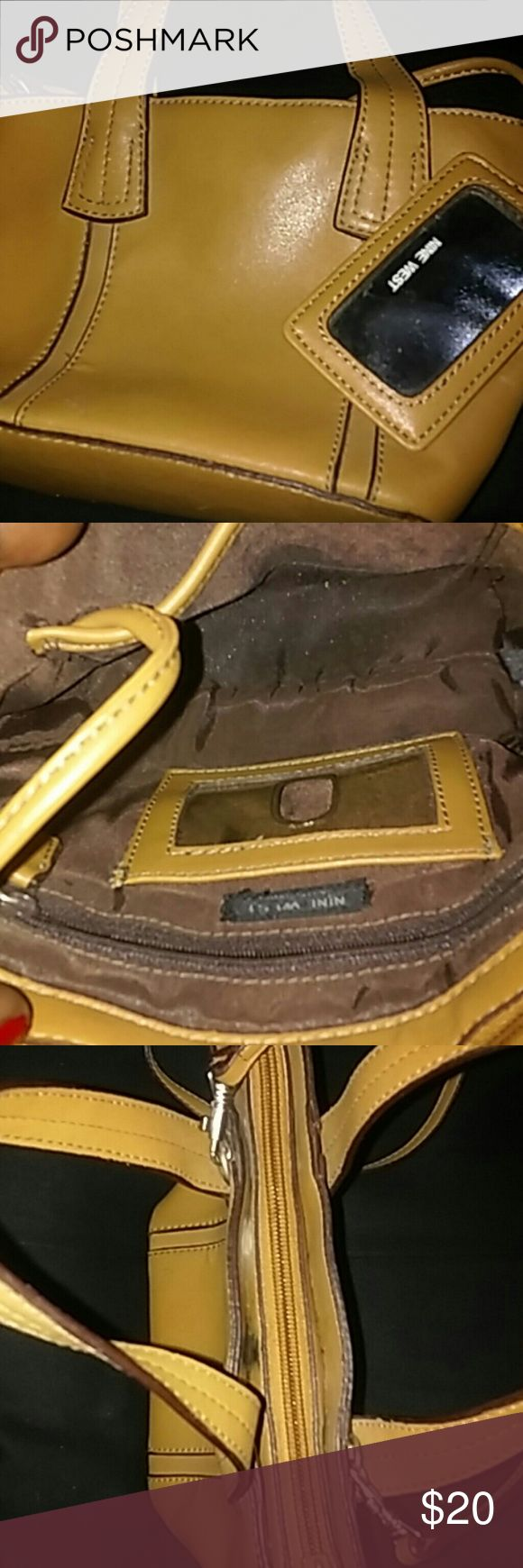 Nine West mini bag with removable long strap Tan leather mini bag with attached mirror inside...onr inside zipper pocket and slot for i.d...small mark see last pic..unnoticeable until you pull apart strap area Nine West Bags Mini Bags
