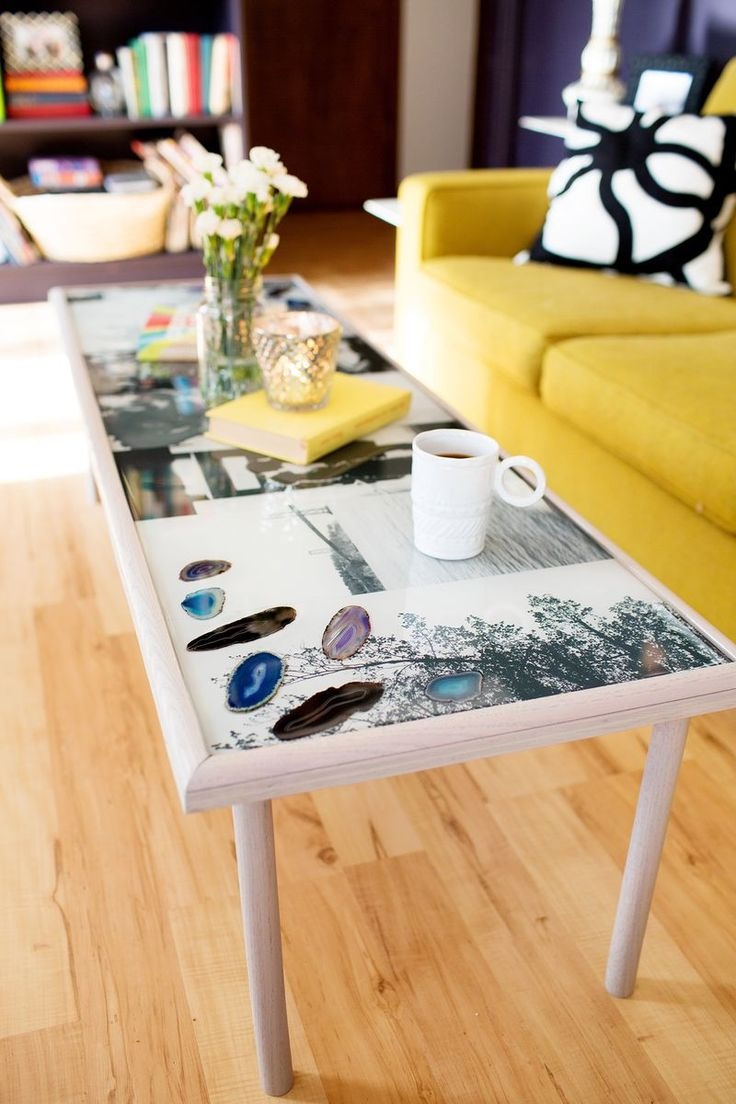 Add more personality to your living space with this photo resin coffee table! You can print out large copies of some of your favorite photographs and add in geode slices or other found objects. Once everything is arranged, it's sealed in a layer of resin for a smooth, clear surface.