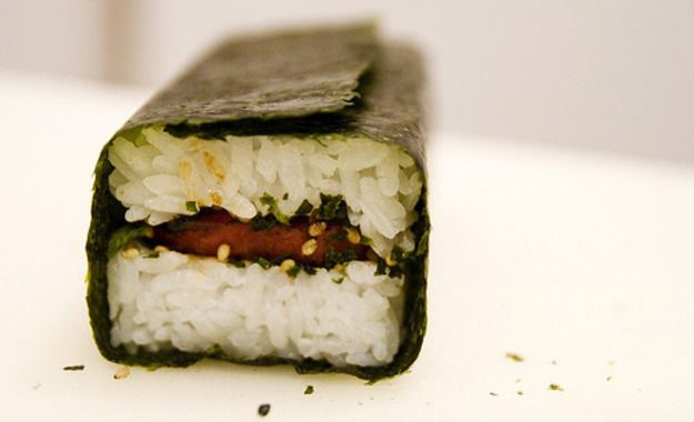 In Hawaii, musubis are found at every convenience shop on the islands, 7-11 included. They're sold in school cafeterias and right alongside butter mochi at local bake sales. Picnic? Someone's mom is bound to make at least two dozen. Sleepover? Either dinner that night, or straight out of the fridge for breakfast. It's a ridiculously simple creation, yet its extremely high rating on the scale of tastiness cannot be denied.