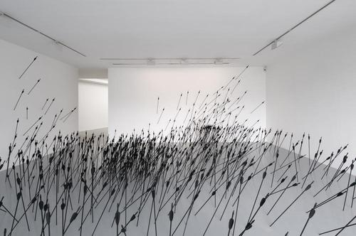 Do you see a peaceful windy meadow? Or an arrow filled battlefield? Installation by Ryan Gander.