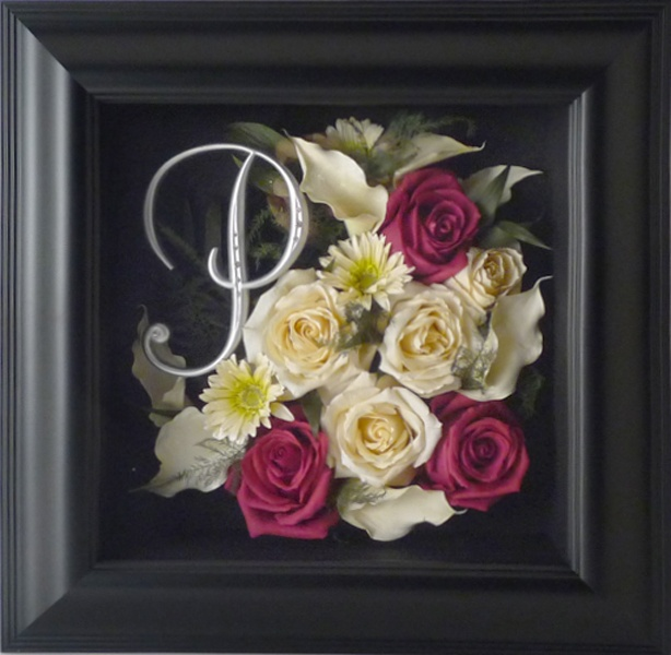 What a great way to preserve your flowers in a contemporary way! Add your cake topper with an assortment of flowers from your bouquet! www.freezeframeit.com