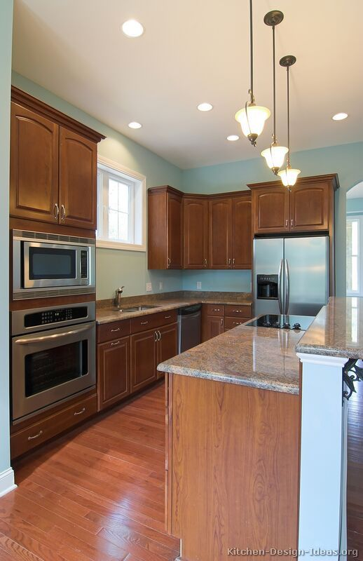 Traditional medium wood cherry kitchen cabinets 15 for Traditional kitchen color schemes