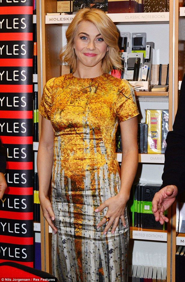 Golden goddess: Julianne Hough glows in gold as she signs copies of Safe Haven for fans at Foyles on Thursday