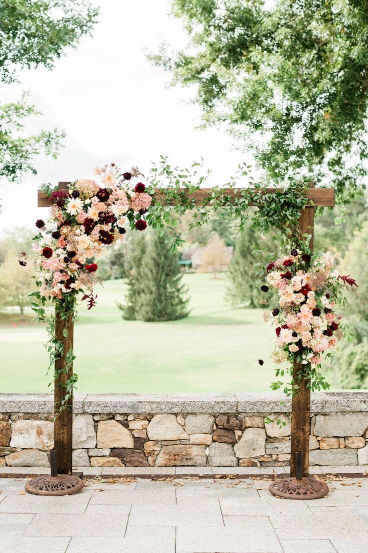 Fall burgundy wedding arch. Fall burgundy wedding arbor. Dahlia wedding arch. Burgundy and blush arch. Photo by AJ Dunlap