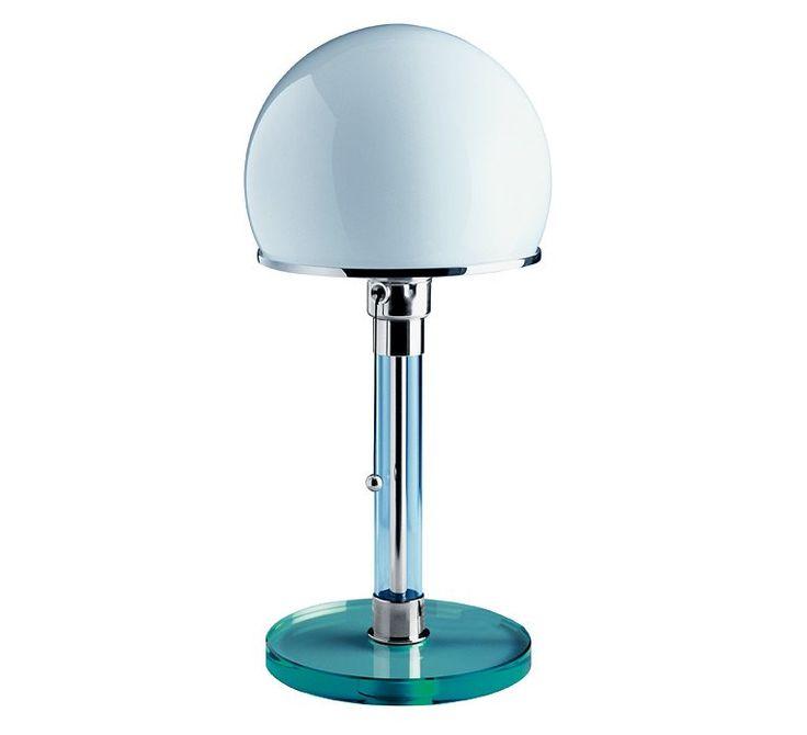 Bauhaus Lampe med glas fod og glasrør Bauhauslampen af Wilhelm Wagenfeld, 1923 Den lille bordlampe er blevet berømt som stilikon for Bauhaus-stilen.  Foden og røret er fremstillet i glas. Lampeskærmen er lavet af opalglas.  Den kan i år fejre 85-års-fødselsdag, men er populær som aldrig før og indbegrebet af moderne design.