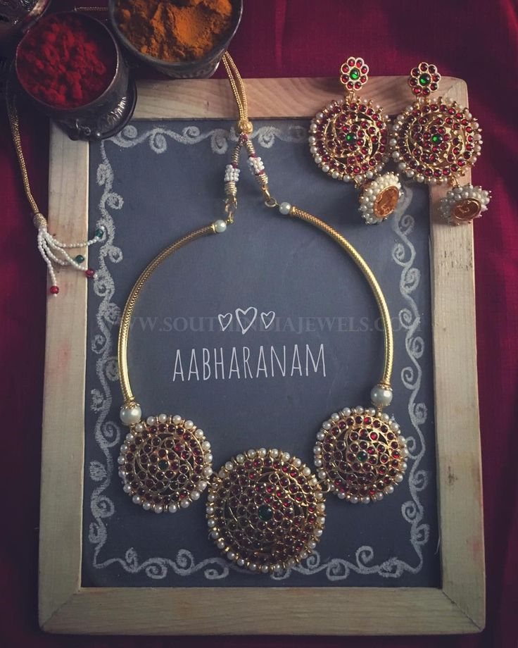 Stunning imitation kemp necklace set. For inquiries please contact the seller below. Seller Name : Abharanam Instagram : https://www.instagram.com/abharanam/ Email : aahbaranam@gmail.com Whatsapp : 9677600195 Related PostsTemple Necklace From AbharanamStone Mango Necklace Set 2017 ModelImitation Pachi Necklace SetImitation Ruby Necklace From Magha StoreSimple Imitation Stone Necklace Set With PriceGold Plated Stone Pachi Necklace Set With …