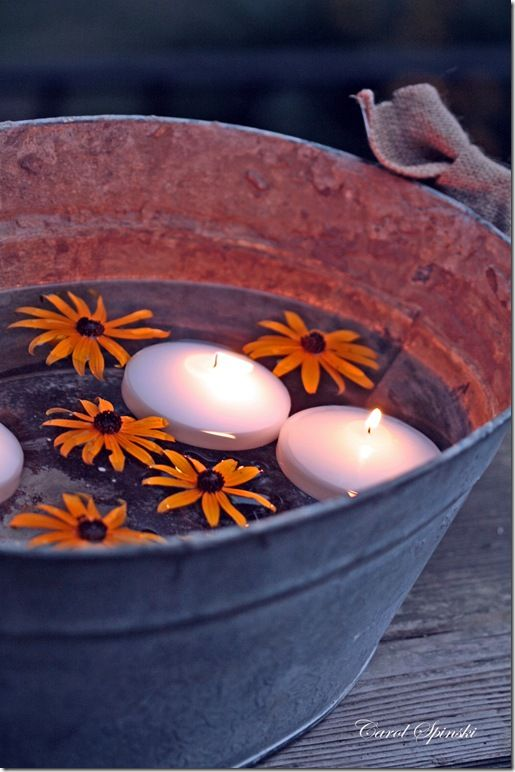<3 ~ floating candles in a galvanized tub