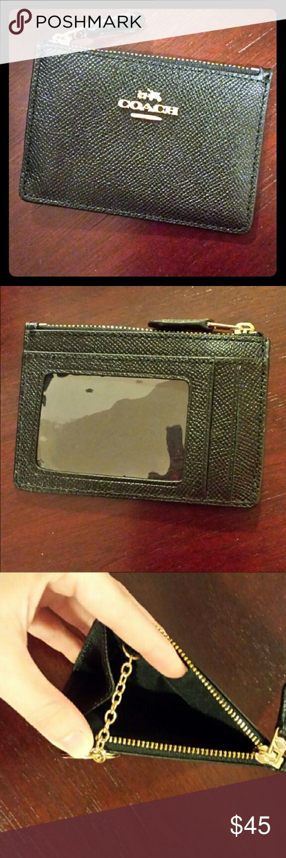 COACH Mini Skinny ID wallet COACH crossgrain leather black mini skinny wallet. Slots on back of wallet for cards and identification. Gold hardware with key fob inside. Zip pouch can be used for change or small loose items inside of purse. Only used twice, excellent condition. Coach Bags Wallets
