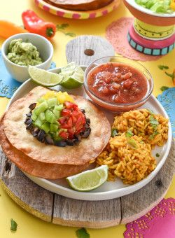 Turn basic corn tortillas into the most festive Cinco de Mayo easy Tostada Sombreros. Dinner is now a fun, holiday-inspired meal!