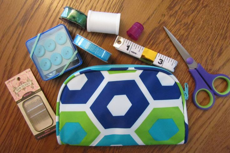 A cosmetic case can make a nice sewing kit, including scissors, notions, ribbon, and whatever you can fit. The square plastic box contains safety pins and straight pins, snaps, small spools of thread, and buttons.