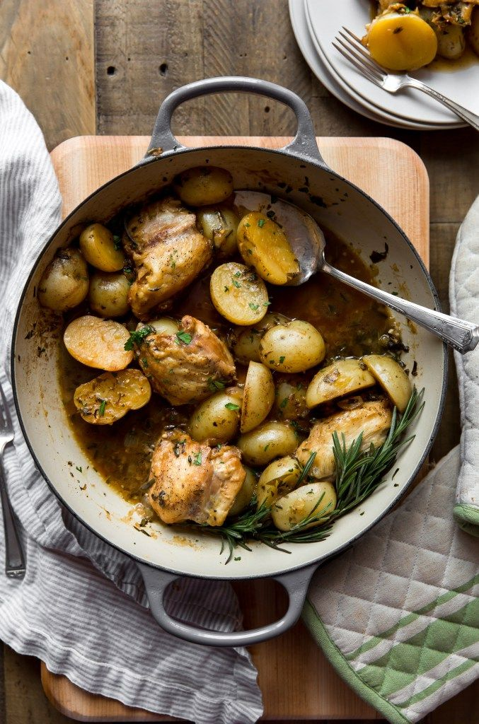 White Wine & Herb Braised Chicken and Potatoes is a winner winner chicken dinner! This one-pot chicken dinner is loaded with flavors of white wine, fresh herbs, butter and decadent chicken and potatoes. Take this pan straight to your table and watch it disappear. Find the recipe on http://kjandcompany.co - KJ & Company #dinner #chickendinner #chickenrecipes #onepot #homecooking #familydinner #potatoes #whitewine