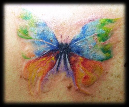 watercolor butterfly tattoo..love the water colors idea! If I get a tattoo
