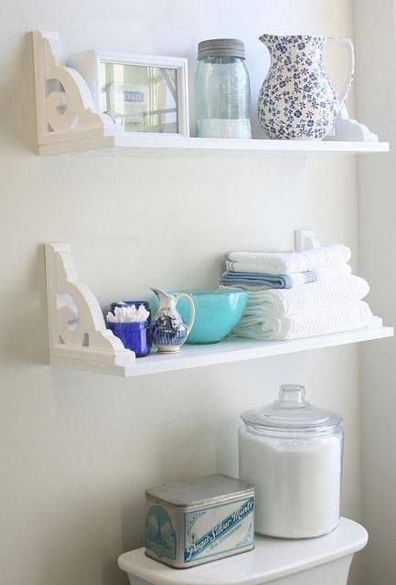 Shelves hung upside down over toilet. from -Chera