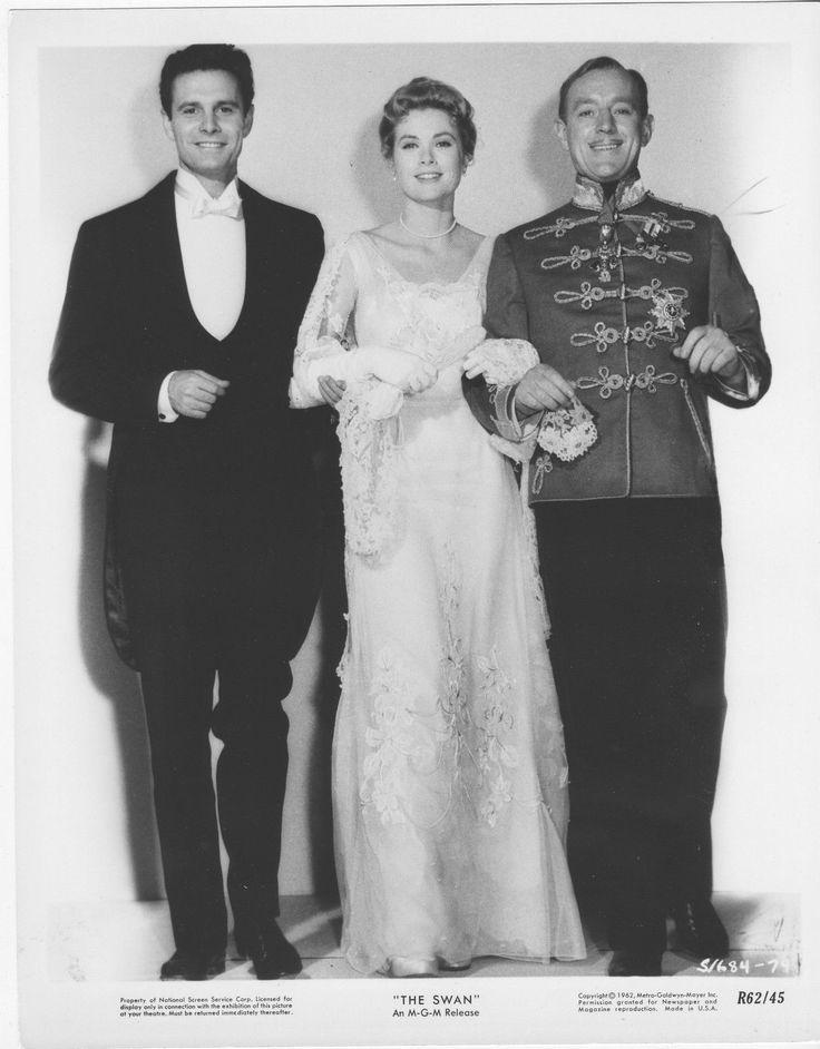 Louis Jourdan. Grace Kelly and Alec Guinness in The Swan, 1956