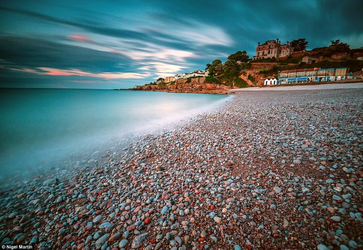 The pebbles on this Devon beach appear to show a myriad of colours under a cloudy sky in Nigel Martin's picture of a storm brewing in Brixham