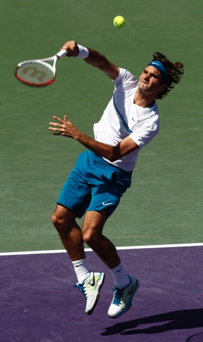 Roger Federer reaching up with his Wilson Pro Staff 90 tennis racket in Miami